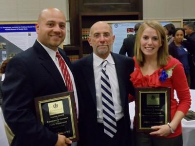 Dr. Jason Irizarry, Dean Thomas C. DeFranco, and Julia Leonard gather at the awards event.