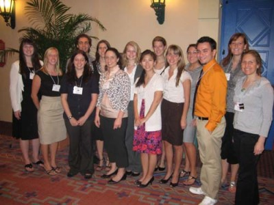 Wendy Glenn, pictured on the far right, gathered with 13 Neag graduates at the ALAN conference in 2010.