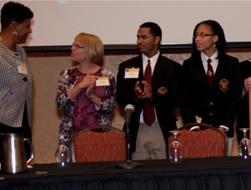 Neag Associate Dean Marijke Kehrhahn (second from left) recognizes the Clark Award with Bulkeley High School representatives Gayle Allen-Greene, Willie Nunez and Shantel Honeyghan.