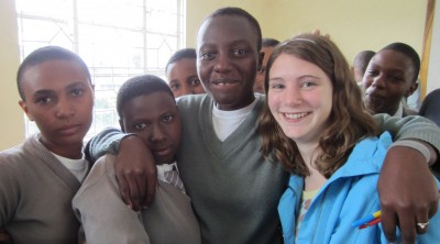 Briana Hennessy gathers with students while in Tanzania. Photo credit: Briana Hennessy