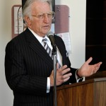 Dr. Phillip Pumerantz at a podium at Western University of Health Sciences. (Photo credit: Western University)