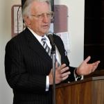 Dr. Phillip Pumerantz at a podium at Western University of Health Sciences. (Photo credit: Western University)