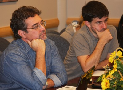Dr. Farinatti and doctoral student (name) listen to research updates from members of the Human Performance Laboratory.