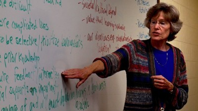 Dr. Bell provides instruction to students in her adult learning class. Photo credit: UConn