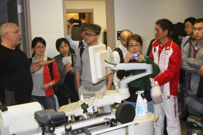 Kinesiology Professor William J. Kraemer provides a tour of a kinesiology lab for the Chinese visitors.