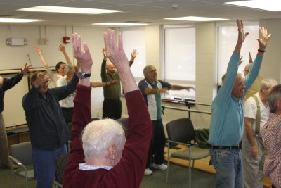 Participants in the Parkinson's study stretch during their exercise class at the Nayden Clinic. Photo credit: Shawn Kornegay, UConn