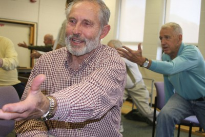Study participant, Bob Bohn, stretches as part of the Parkinson's study exercise class. Photo credit: Shawn Kornegay, UConn