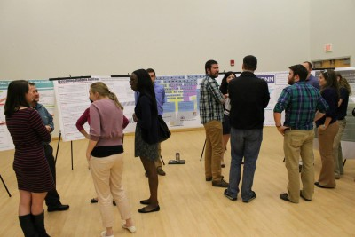 HESA Students present their assessment project posters to conference attendees