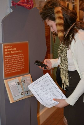 Neag alumnus Ashley Sullivan, who teaches history at Ridgefield HS, used her smartphone to review the footnotes while attending a special preview with fellow Neag history education majors at the Fairfield Museum.