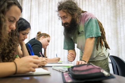 Patrick Dragon, assistant professor-in-residence of mathematics, worked with high school students who hailed from as far away as California, during the Mentor Connection program. (Peter Morenus/UConn Photo)
