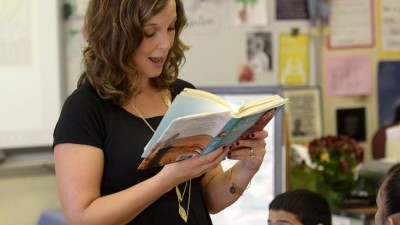 """One teacher, one pen, one book can change the world,"" reads teacher Cara Quinn from the book ""I Am Malala"" to her sixth-grade class at Sunset Ridge School in East Hartford. Quinn has been named the 2015 Connecticut teacher of the year. (Patrick Raycraft -- Courant)"