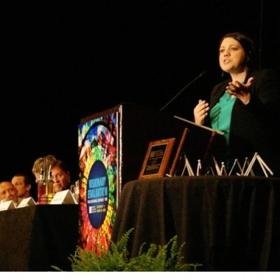 Bianca Montrose-Moorhead gives her acceptance speech at AEA's national meeting.