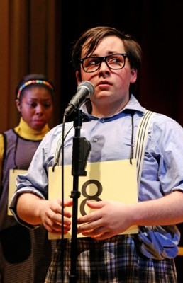 Ryan Shea '17 (SFA) steps up to the microphone, while Whitney Andrews '15 (SFA) looks on, in the Connecticut Repertory Theatre's production of 'The 25th Annual Putnam County Spelling Bee.' (Gerry Goodstein for UConn)