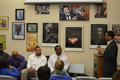 Neag Assistant Professor Joseph Cooper, right, poses questions to a panel of UConn student-athletes at the African American Cultural Center on March 12, 2015. The athletes are participants in an organization Cooper established this past fall called Collective Uplift.