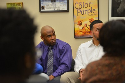 UConn student-athletes Marquise Vann, left, and Gus Cruz, right, participate in a panel discussion about the stereotypes faced by student-athletes of color.