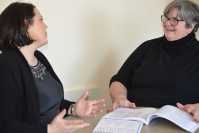 Suzanne Wilson (on the right), who is also heading up Neag's new faculty mentoring efforts, discusses the project with Bianca Montrosse-Moorhead.