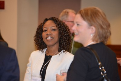 Deans Doctoral Scholars finalists meet with Neag faculty on February 8, 2015, at the Rome Commons Ballroom in Storrs. Sian Charles-Harris speaks with Associate Dean Sandra Chafouleas.
