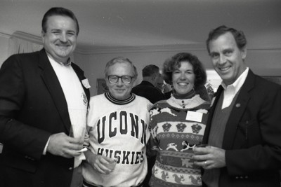 President Harry Hartley, wearing a UConn sweatshirt, at a brunch in October 1990. (University of Connecticut Photograph Collection, Archives & Special Collections, UConn Libraries)