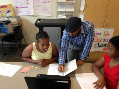 Cedric Scott facilitates an enrichment cluster focused on cooking, nutrition, and food safety. He was conferencing one-on-one with a student to give her pointers on a project she was working on.