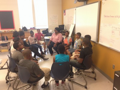 "Ms. Kim Bigelow facilitated an enrichment cluster on social justice. They were having a discussion on the ""Black Lives Matter"" movement and how that is or is not a example of a social justice movement, how it compares to ones in the past, etc. (Photo credit: D.C. Public Schools)"