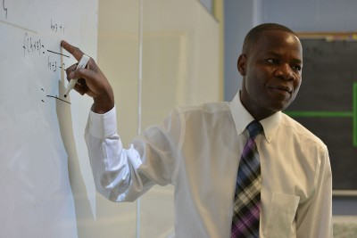 Neag alumnus, Zato Kadambaya, teaches a math lesson at New London High School in New London, Conn.